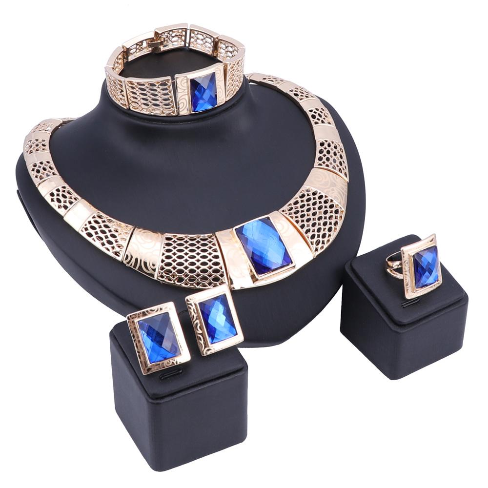 Женский комплект из колье серёг браслета и кольца