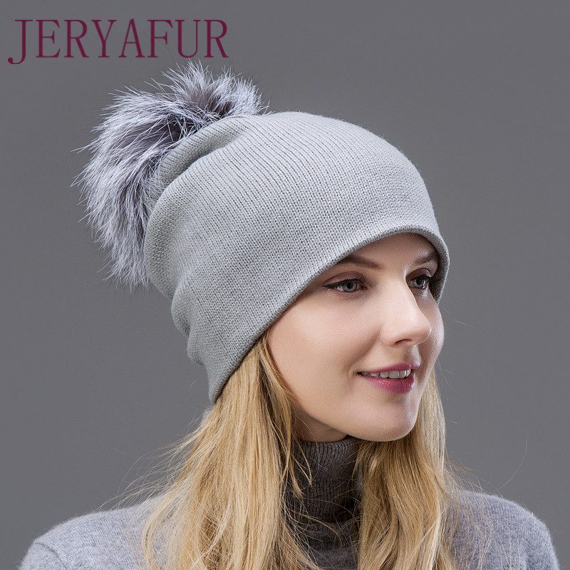 2017 Hot The wool knitted hat spring autumn and winter warm earmuffs hat beautiful woman's cap with Fox fur Pompom on the top