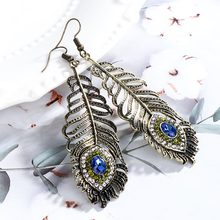 цены на Vintage Rhinestone Tassel Dangle Earrings for Women Peacock Eye Feather Dangle Earrings Hangers Statement Earrings Jewelry  в интернет-магазинах