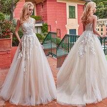 נפלא טול תכשיט מחשוף אונליין חתונת שמלה עם תחרה אפליקציות & 3D פרחים שמפניה כלה שמלות