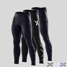 De compression pantalon hommes Automne et d'hiver collants running pantalon fitness pantalon élastique marathon rapide-séchage