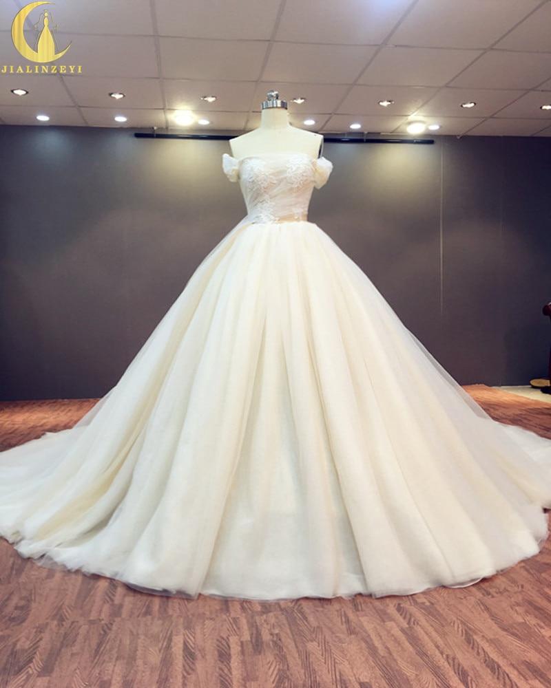 Ryzí skutečný vzorek Sexy šampaňské člun krk s krajkou A-line zametání dlouhý vlak luxusní svatební svatební šaty svatební šaty