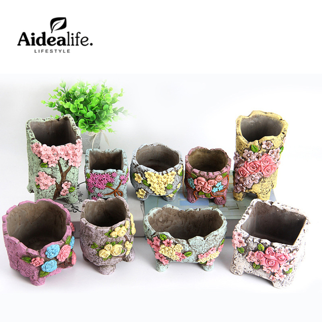 Pocket gardens outdoor planters clay potconcrete molds for Decorative outdoor pots
