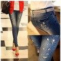 2016 nueva Otoño invierno Rhinestone Rebordear Jeans mujer jeans rasgados agujero mujeres denim pantalones lápiz pantalones femeninos G0504