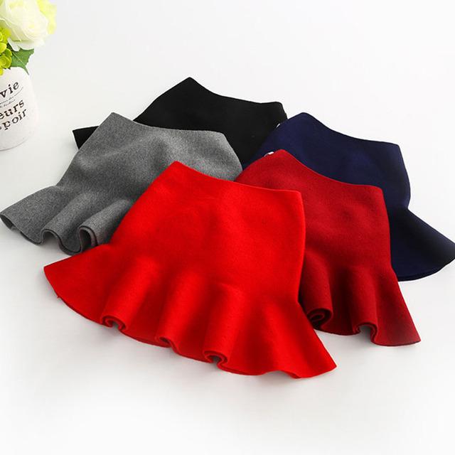 Lana de punto sólido muchachas de la falda corta de media falda de 2017 de los nuevos niños Coreanos ropa falda de los niños