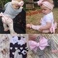 2016 otoño nueva llegada del bebé muchachas del niño del algodón de la manera del leopardo rosa arco pantalones polainas de los niños al por mayor puede elegir tamaños