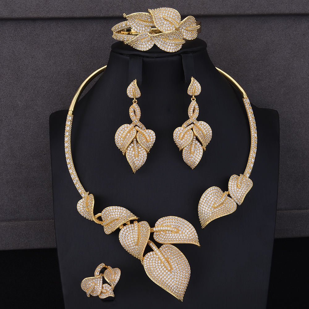 4PCS Luxury Leaf Shape Indian jewellery sets for women CZ Collar Necklace Earrings Bracelet Ring Jewelry Sets Wedding Wear a suit of delicate rhinestone hollow out leaf necklace bracelet earrings and ring for women