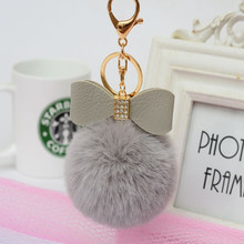 Cute Bowknot Pendent Gold Rabbit Fur Ball Keychain Fur Pom Pom Key Chain Fur Keyring Porte Clef Llaveros Pearl Keychain For Bag 2019 hot pompom unicorn keychain colorful fake rabbit fur ball fluffy licorne key chain horse porte clef wome bag car keyring