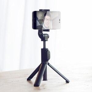 Image 2 - 100% המקורי xiaomi כף יד מיני חצובה 3 ב 1 דיוקן עצמי חדרגל טלפון Selfie מקל Bluetooth אלחוטי מרחוק תריס שחור