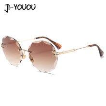 JIYOUOU sol para las mujeres 2018 nuevas gafas de sol polarizadas ronda  caleidoscopio gafas sin marco gafas de sol alta calidad . 735b2ecb4872