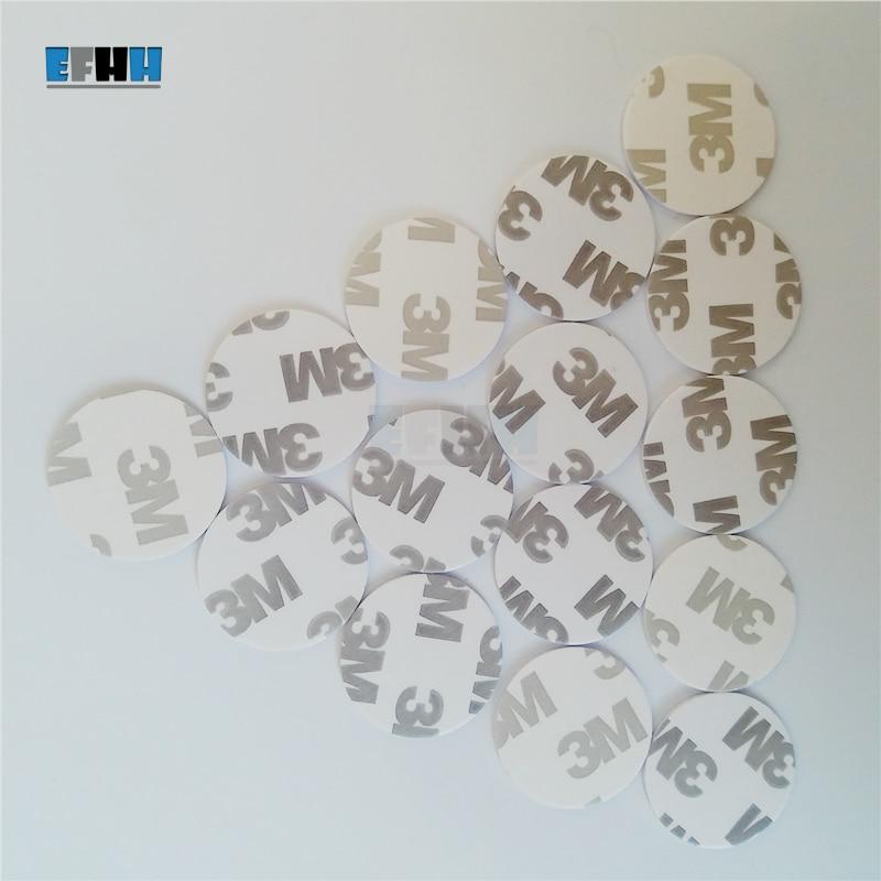 купить 125KHZ T5577/T5557/T5567/T5200 Rewritable RFID Coin Card With 3M Adhensive Sticker In Access Control Card (Diameter 25mm) по цене 38.08 рублей