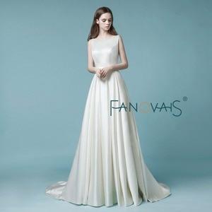 Image 2 - Vestido de casamento de cetim 2019 vestido de noiva simples gelinlik com bolso marfim sem costas cristal vestido de noiva
