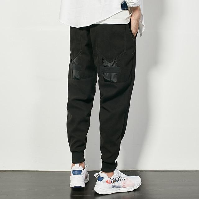 Los hombres de punto ocasional de las bragas de alta calidad de la marca de empalme pantalones de hip hop harén pantalones masculinos de la moda negro pantalones sueltos K138