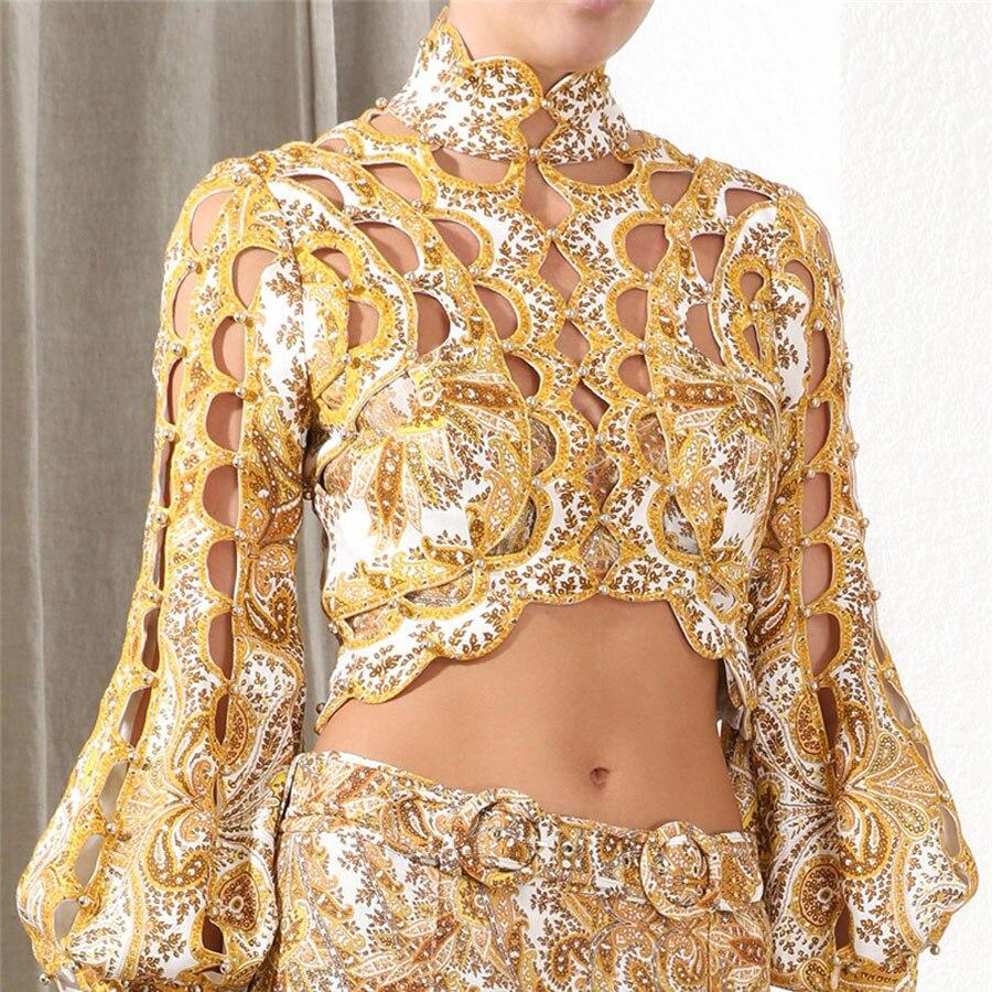 2019 nouveauté femmes mode Sexy Blouse chemise évider perles motif court Style chemise haute manches bouffantes or Blouse femmes
