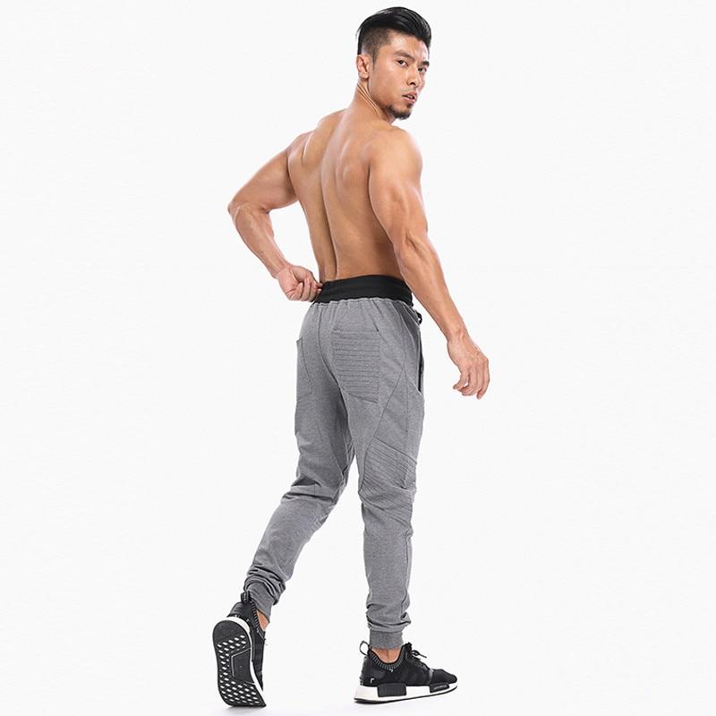 Click here!! Novos Homens Calça Casual Elastic Cotton Mens Treino de  Fitness Ginásios Do Corpo Calças Skinny ab7259b474805