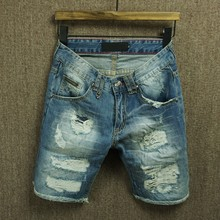 The summer youth men's wear thin white denim shorts and a hole in the beggar small straight pants five