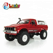 цена Profession Eelectric Toys 2.4G rc 1:16 Metal Remote Control Cars with Light rc Monster Truck Wltoys carro de controle remoto онлайн в 2017 году