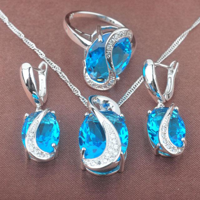 Nueva Banda Cielo Azul Cubic Zirconia Mujeres Pendientes de 925 Plata de La Joyería Collar Colgante Anillos Envío Gratis TZ084