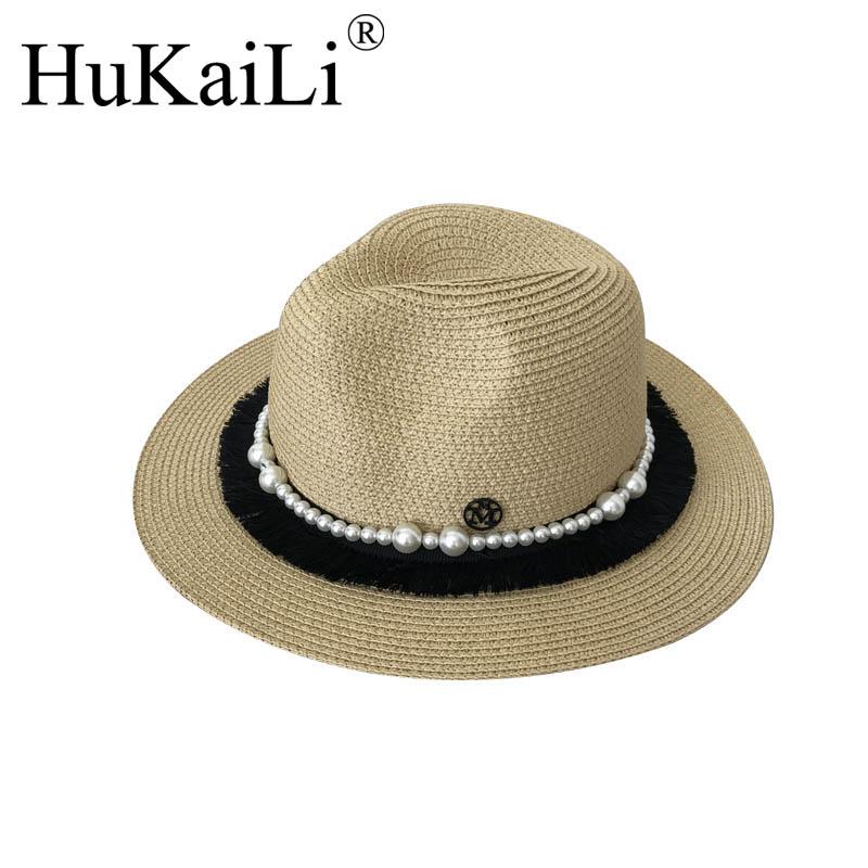La nueva paja del jazz doble de metal negro logotipo de la perla borla  protección solar ocio sombrero femenino en Sombreros de sol de Accesorios de  ropa en ... 3c7494c4c6e