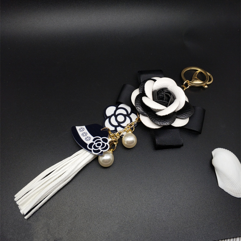 Genuine Leather Black&White Male&Female Keychain Bag Plush Car Key Ring Car Key Camellia Flower Hat Tassel  Style Key Chain