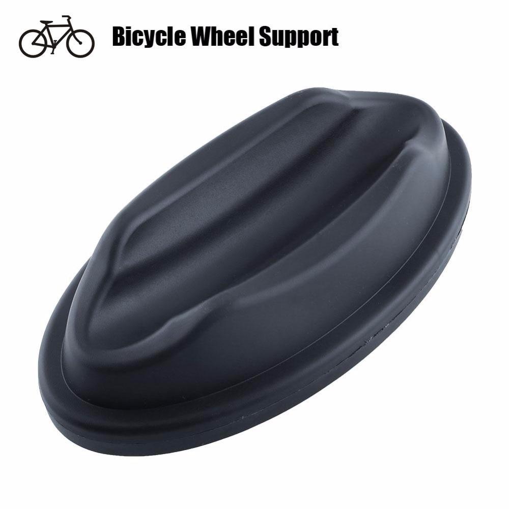 Goma negro rueda delantera Riser bloque para Turbo interior entrenador  deportivo Bicicletas carretera ciclo Accesorios de bicicleta 9b62825895e