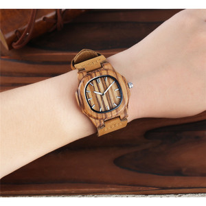 Image 5 - Men Women Wooden Watch Creative Round Shape Dial Light Wood Case Genuine Leather Band Bamboo Wood Clock Male Reloj de madera TOP