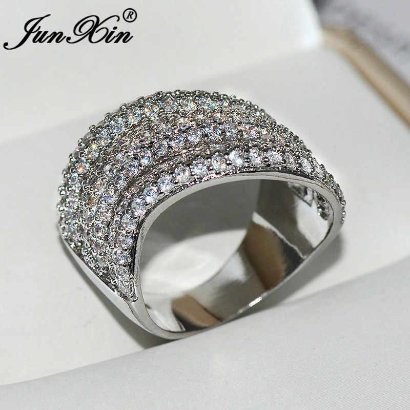 JUNXIN หญิงหรูหราคริสตัลหมั้นแหวน 925 เงินสีขาว Zircon Geometric Wave แหวนสำหรับเครื่องประดับงานแต่งงานของผู้หญิง