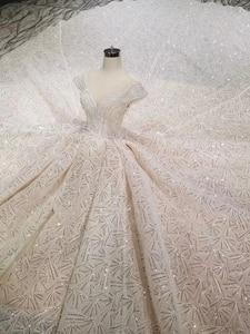 Image 3 - HTL001 Luxury shiny wedding dresses crystal cap sleeve illusion o neck handmade wedding gown open keyback vesridos de novia