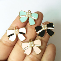 Free Shipping 20PCS Fashion Pearl Core Decorated Enamel Knot Bow Alloy Jewelry Pendant Charms Gold Tone