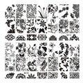 10 unids/lote nueva flor negro mariposa del cordón del clavo que estampa las placas de acero inoxidable plantilla del sello del arte de manicura herramientas del clavo