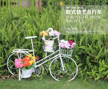 The window decoration creative shooting props green plant bicycle European multi-layer iron art flower stand.