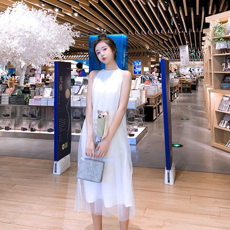 Robe en mousseline de soie blanche fée dames robe élégante en mousseline de soie romantique mode mignon sans manches filles robe Super belle robe des femmes