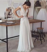 ללא משענת אור שיפון חתונת שמלות תחרה Aplliques שווי שרוולים סקסי V מחשוף עם גבישי מותן כלה שמלות נדן חצאית