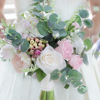 Iffo European French country wedding wedding bride holding flowers pink rose lily blue eucalyptus bouquet