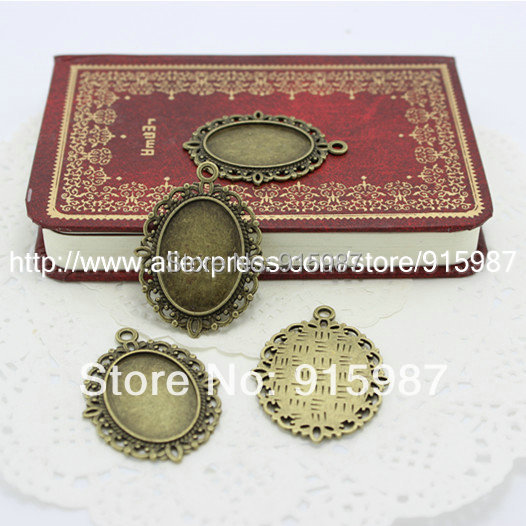 Sweet Bell 50pcs lot New Fashion vintage bronze oval filigree cameo pendant  blanks settings 101f681d3ee6