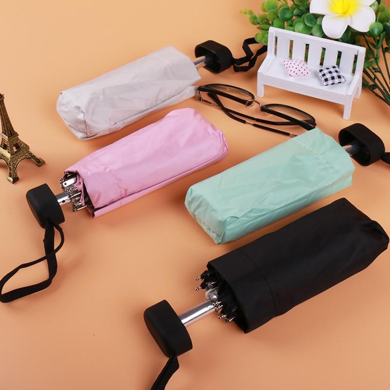 Nuevo portátil de los hombres paraguas Mini bolsillo paraguas evitar Uv impermeable plegable damas cinco veces paraguas de sol venta libre