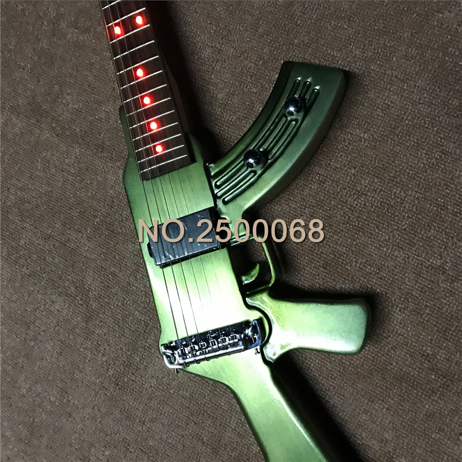 electroplate green finish guitar gun shape cool electric guitar made in china in guitar from. Black Bedroom Furniture Sets. Home Design Ideas