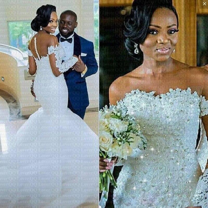 2019 New Arabic African Long Sleeve Mermaid Wedding Dress Sheer Neck Crystals Beading Wedding Gowns