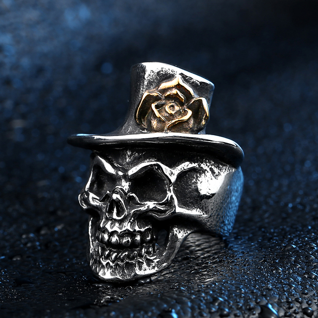 STAINLESS STEEL SKULL WITH GOLD ROSE RINGS