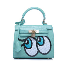 The new Korean lady handbag fashion sequins eye candy colored mini women shoulder bag female buckle