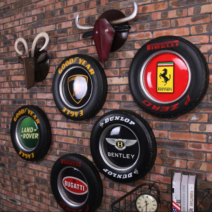 Retro industrial wind car tires LED lights net coffee bar cafe metal painting wall decoration.Retro industrial wind car tires LED lights net coffee bar cafe metal painting wall decoration.