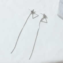 Long exaggerated fringed triangle ladies earrings