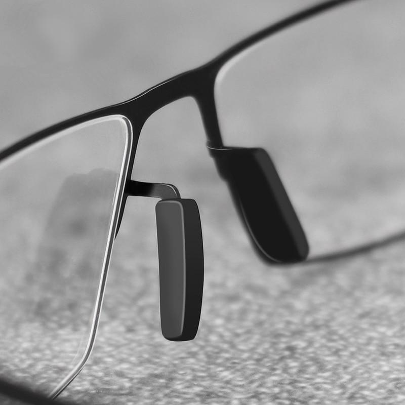5d66646dea Aleación de titanio TR90 hombres ultraligero gafas 2019 hombre miopía marco  óptico de gafas sin tornillos