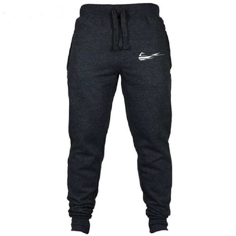 2018 de alta calidad pantalones hombres Fitness culturismo gimnasios pantalones para los corredores de marca de ropa de otoño sudor Pantalones