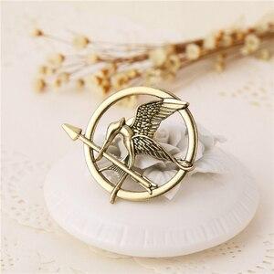 Image 3 - Hunger Games Brooch Pin Bird Eagle Arrow Logo Badge Vintage Fashion Hot Animal Game Movie Jewelry For Men Women Kids Wholesale