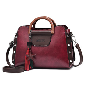 Image 1 - ETONTECK 2018 New Fashion Luxury Women PU Leather Handbags Vintage Rivet Tassel Messenger Bag for Female Ladies Shoulder Bag
