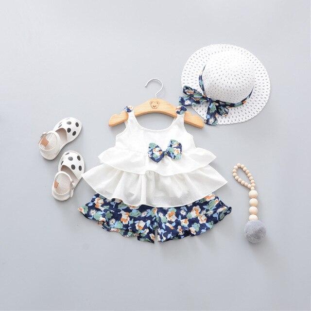35d9c7d06d17 2018 Summer Newborn Baby Girl Clothes Strap Bow Vest + Floral Shorts +  Fashion Hat 3Pcs