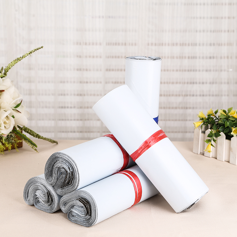 25*31+4cm 50Pcs/ Lot White Plastic Express Mailer Pouch Mailers Bag Soft Mailing Pocket Express Courier Party Package Envelope