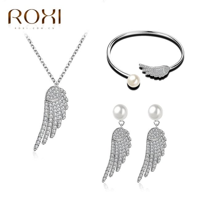 ce27c60790 ROXI Freedom Wing Bracelet/Earrings/Long Necklace Imitation Pearl Pendant  Fashion Jewelry Set White