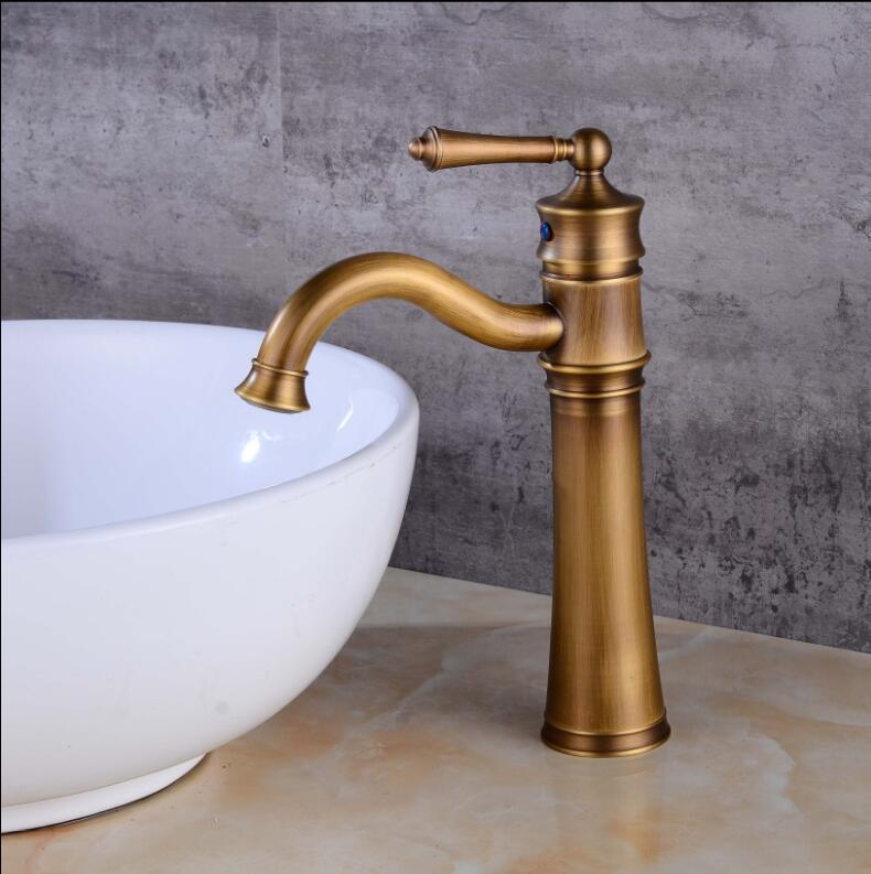 все цены на Antique Brass Basin Faucet Brass Basin Crane Rotating Bathroom Sink Faucet Single Handle Waterfall Faucet Wash basin Mixer Taps онлайн